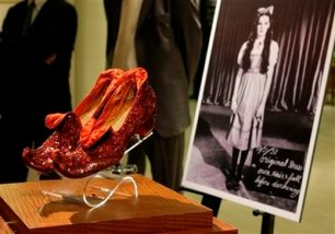 "Judy Garland's Arabian ruby slippers, one of five pairs designed by Adrian Greenberg of MGM studios and worn by Garland for test and wardrobe shots in the 1939 film ""The Wizard of Oz, "" are displayed at Saks Fifth Avenue in New York, Thursday, Sept. 4, 2008, part of an exhibit of ruby shoes created along the gemmed red slippers theme by well-known designers. Considered the most rare of all the ruby slippers used while making the film, the pair shown are owned by actress Debbie Reynolds. (AP Photo/Kathy Willens)"