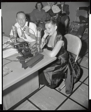 Judy Garland and Jack Eigen Talking in Radio Microphones