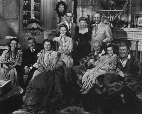 Director Vincente Minnelli and producer Arthur Freed pose with the cast of