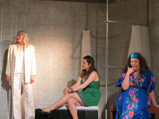 The fine ladies already in the holding cell: Gladys Symmington-Bucovitch - muderer (Rosanne Coates), Val - hooker (Sarah Budgell, Dottie Ramsbottom - shoplifter (Shirley Jollimore) watch Essie's arrival.