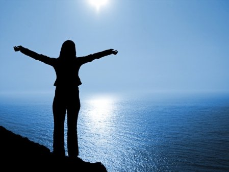 woman-empowered-on-top-of-the-world