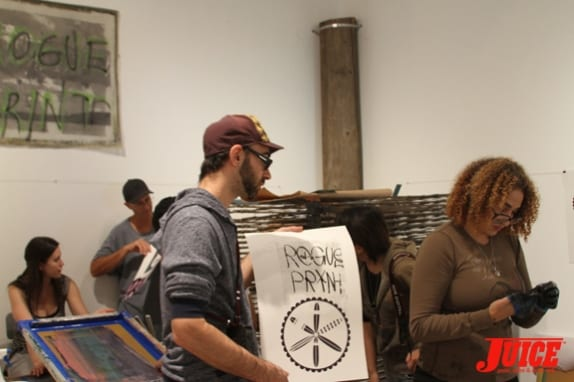 Curator Lee and His Art. Photo: Dan Levy