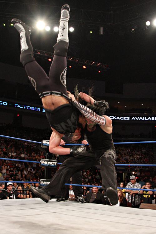 Jeff Hardy front suplexes AJ