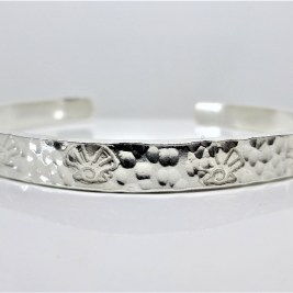 Solid Silver Torque Bangle with Shell design. Adjustable.
