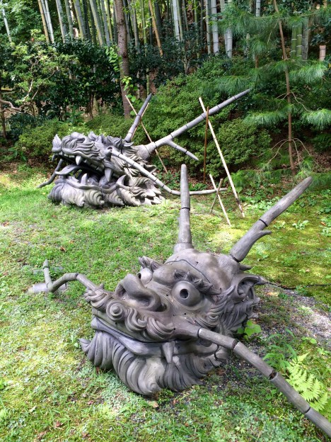 Mighty wood dragon heads, in the peaceful gardens of the Kodaiji temple.