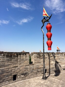 The bright red of this lamp post contrasts vividly with the bright blue sky (one of the few we had a chance of seeing in China)