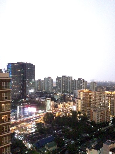 A lightning strike turns night into day, seen from the balcony of our AirBnb apartment in Bangkok
