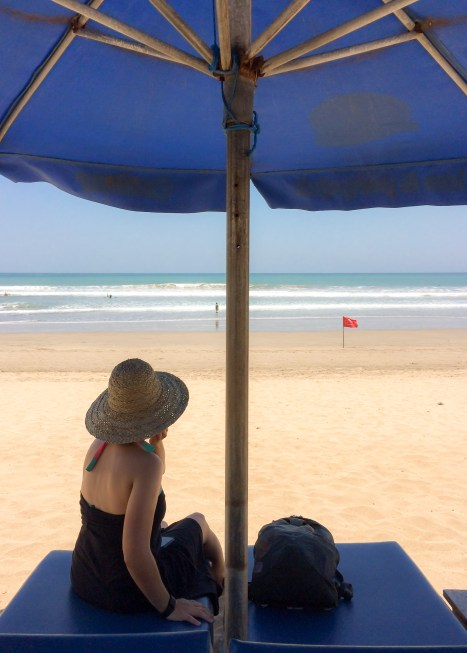 Wondering about the red flag? Kuta has strong currents, even with the sea looks calm