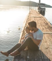 Man and baby on a dock