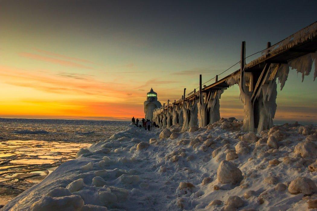 Lighthouse on frozen beach