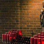 Votive lights, statue in chapel
