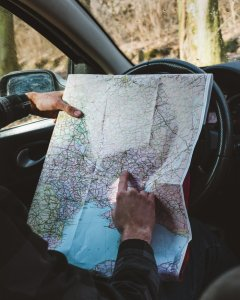 Person holding map in auto