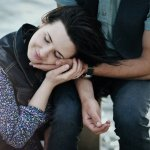 Man comforts woman