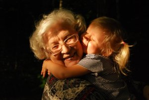 Child hugging older woman