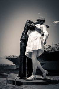 WW II Sailor kissing girl