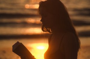 Girl reading in sunset