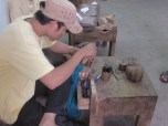 A Male Artisan Doing Copper Work