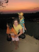 Me, Pissa, and Pipi Watch the Sun Set Over the Newly Harvested Sugar Cane Fields in Singburi, Thailand