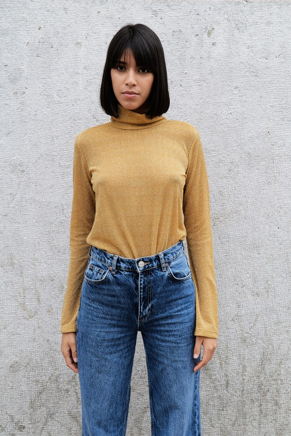 Beautiful yellow sparkle blouse is made in Italy. Ethical fashion brand is designed from a Canadian.