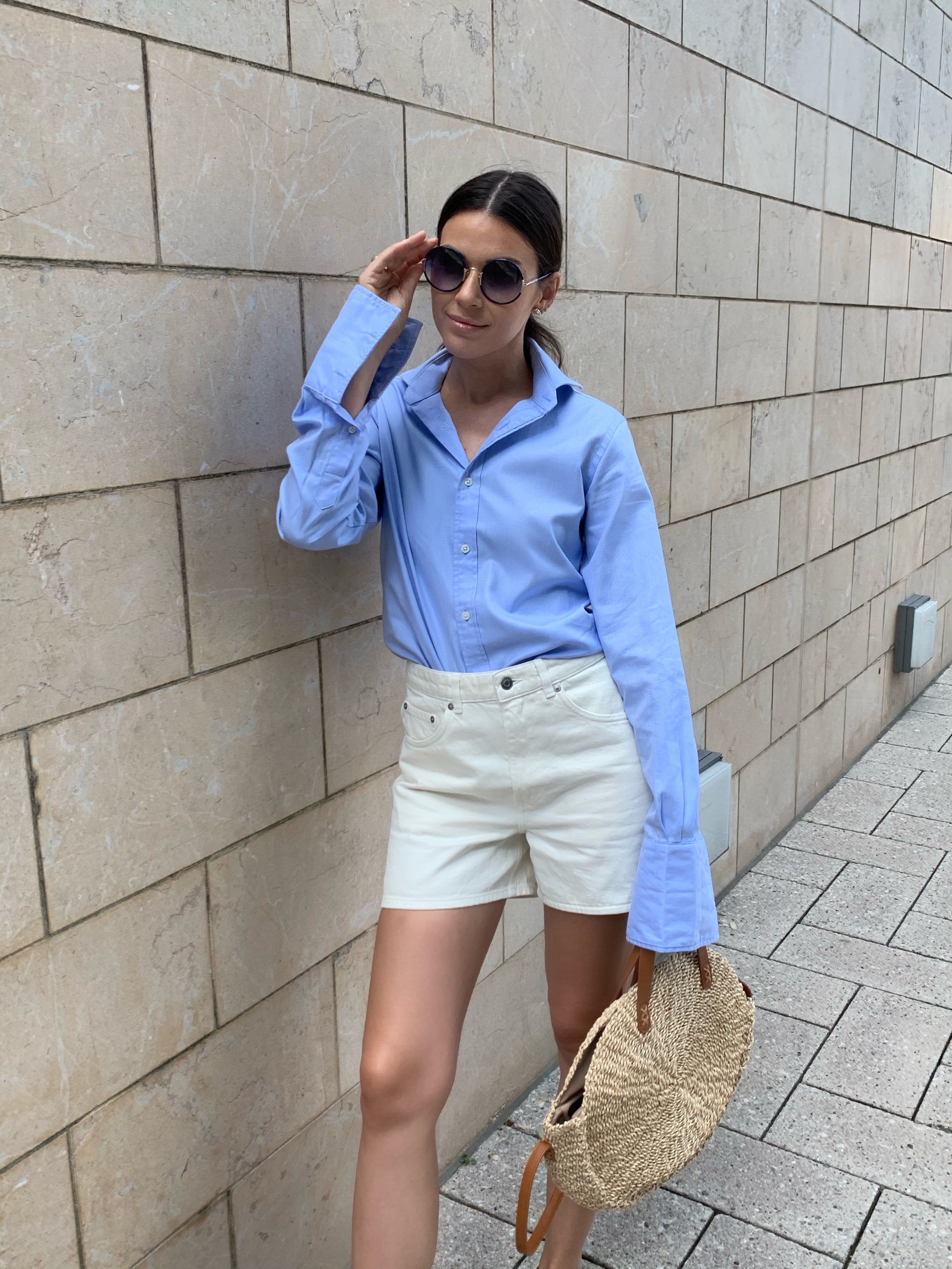 blue shirt and off-white shorts outfit