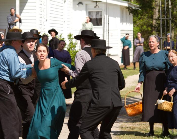 Adelaine Kane as Ruth. Held against her will by the men of Amish community to keep her from talking to the police.
