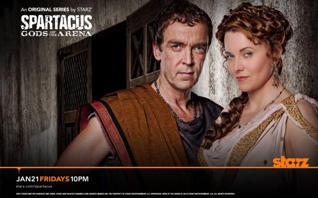 Spartacus: Gods of the Arena. John Hannah as Batiatus and Lucy Lawless as Lucretia