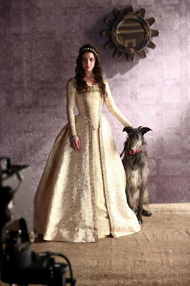 Adelaine Kane as Mary Queen of Scots with her beloved royal dog.