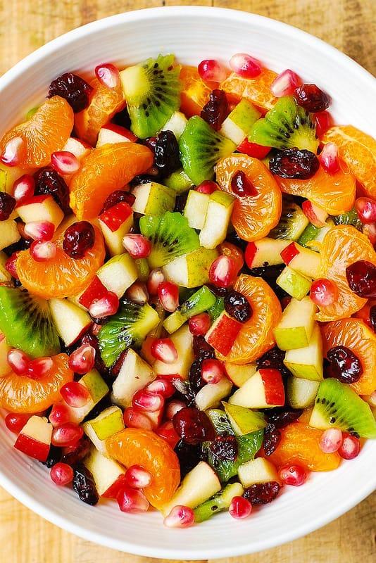 Mandarin or clementine oranges, kiwi fruit, apples, pears, pomegranate seeds, cranberries, maple lime dressing