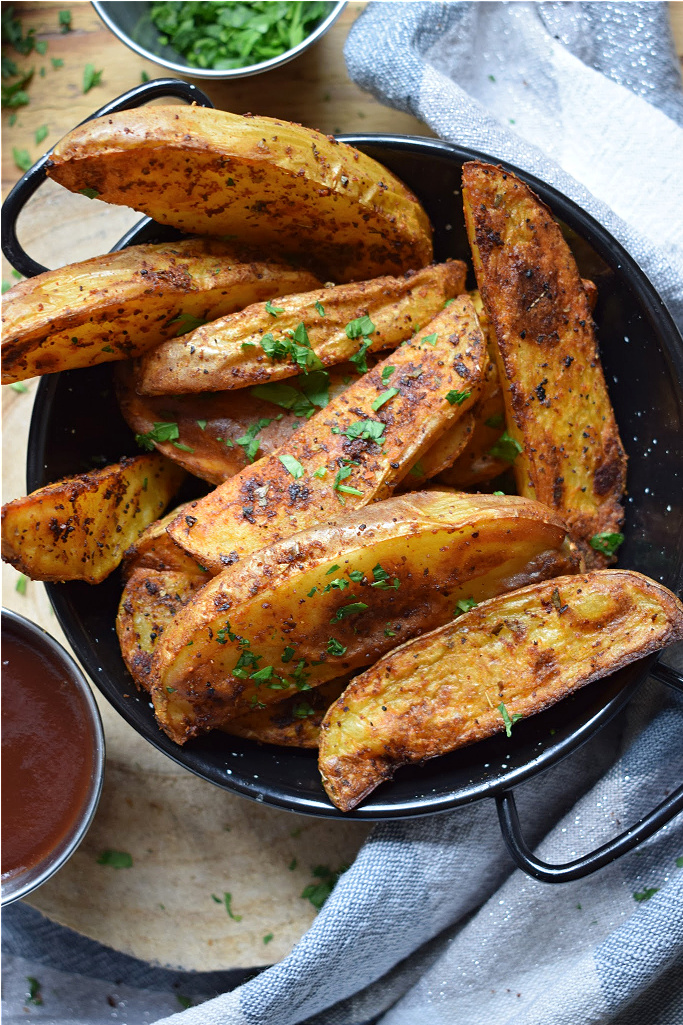 close up of papriks spiced potato wedges