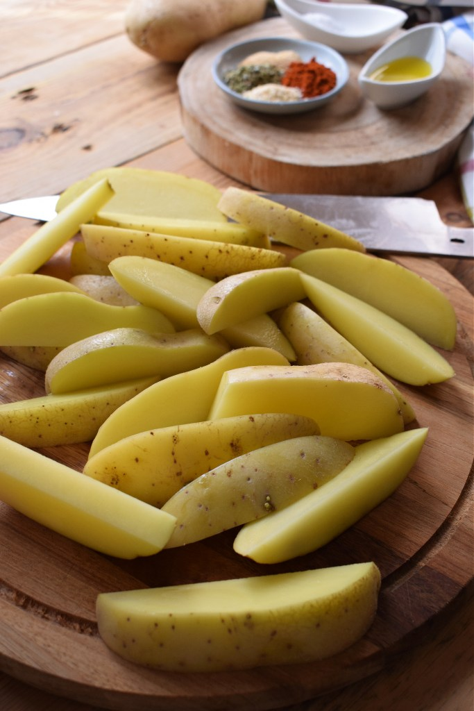 slices potatoes on a cutting board