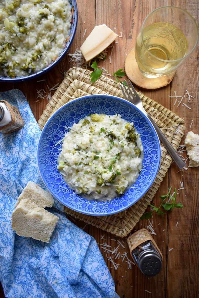 Table setting of the creamy broccoli risotto with a glass of wine