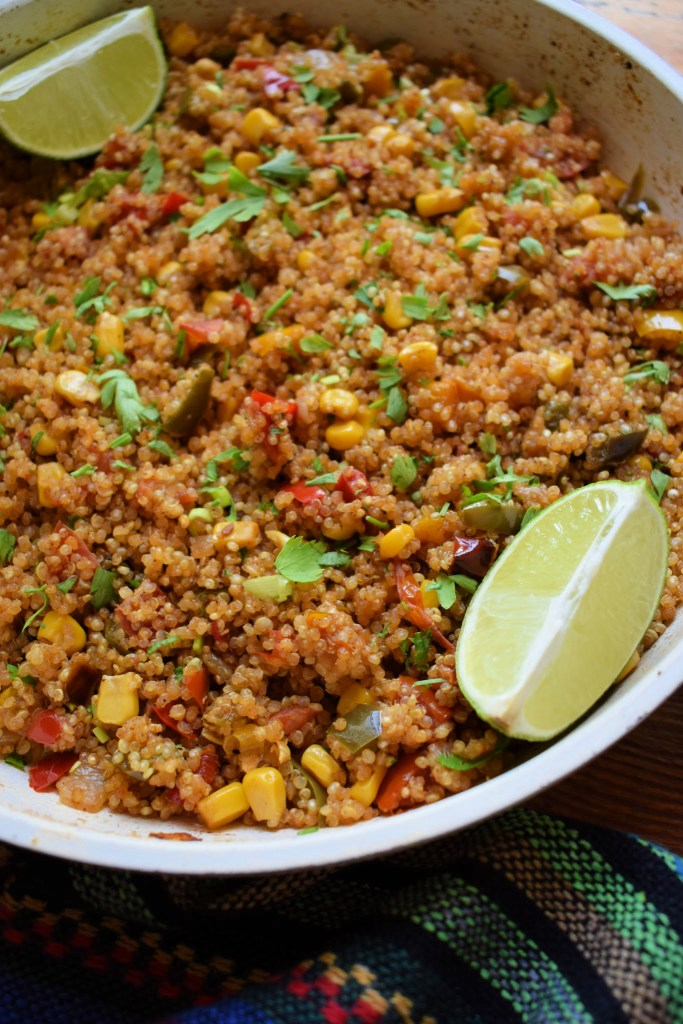 Close up of southwestern style quinoa with lime wedges
