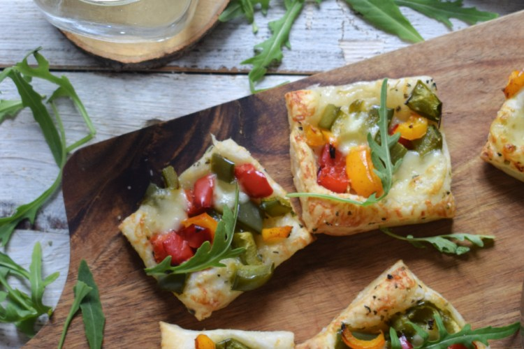 over head view of the Roasted Bell Pepper Puff Pastry Bites with a glass of water