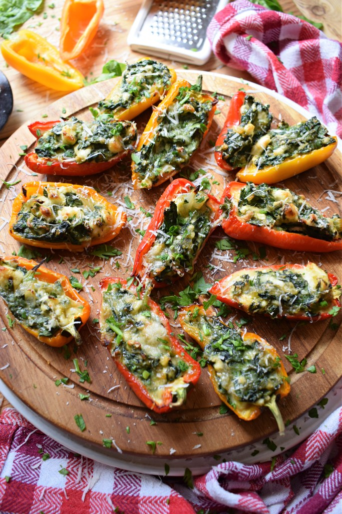 the feta and spinach peppers on a wooden tray