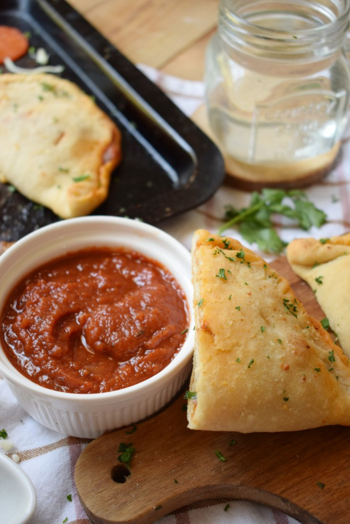 Homemade Calzones with marinara sauce