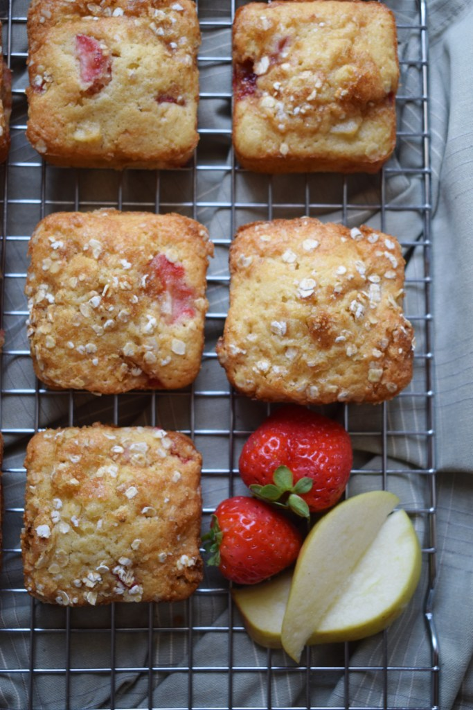 over head view of the strawberry and apple muffin recipe on a cooling rack