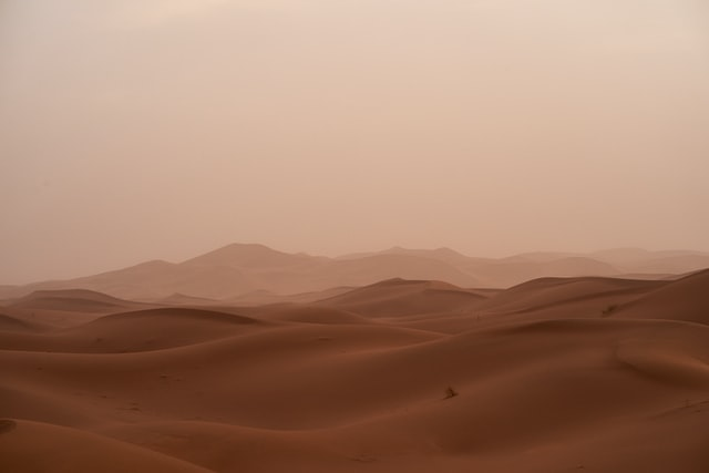 Why do people travel in inhospitable places the sahara desert