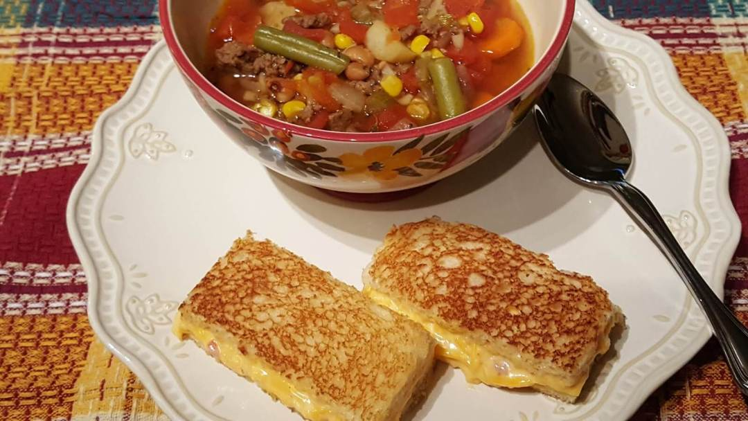 hamburger vegetable soup with a pimento cheese grilled cheese sandwich