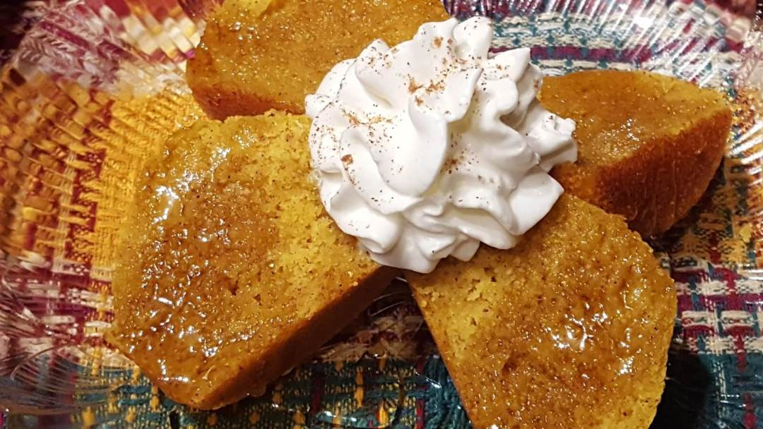 Pumpkin Cornbread Muffin with honey and whipped cream and cinnamon