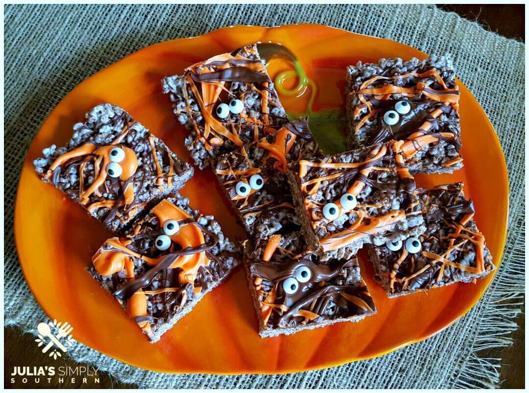 Halloween Krispie Treats on an orange pumpkin platter