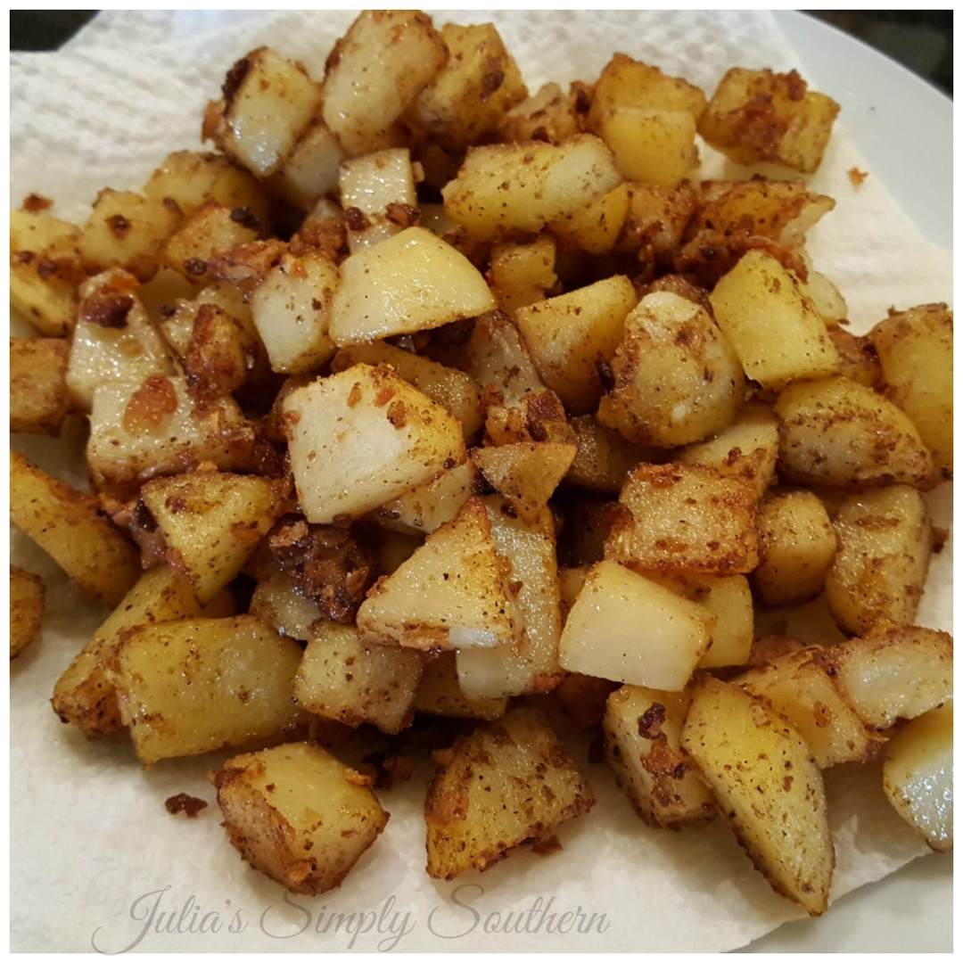 Southern Style Pan Fried Potatoes in a cast iron skillet - Julia's Simply Southern