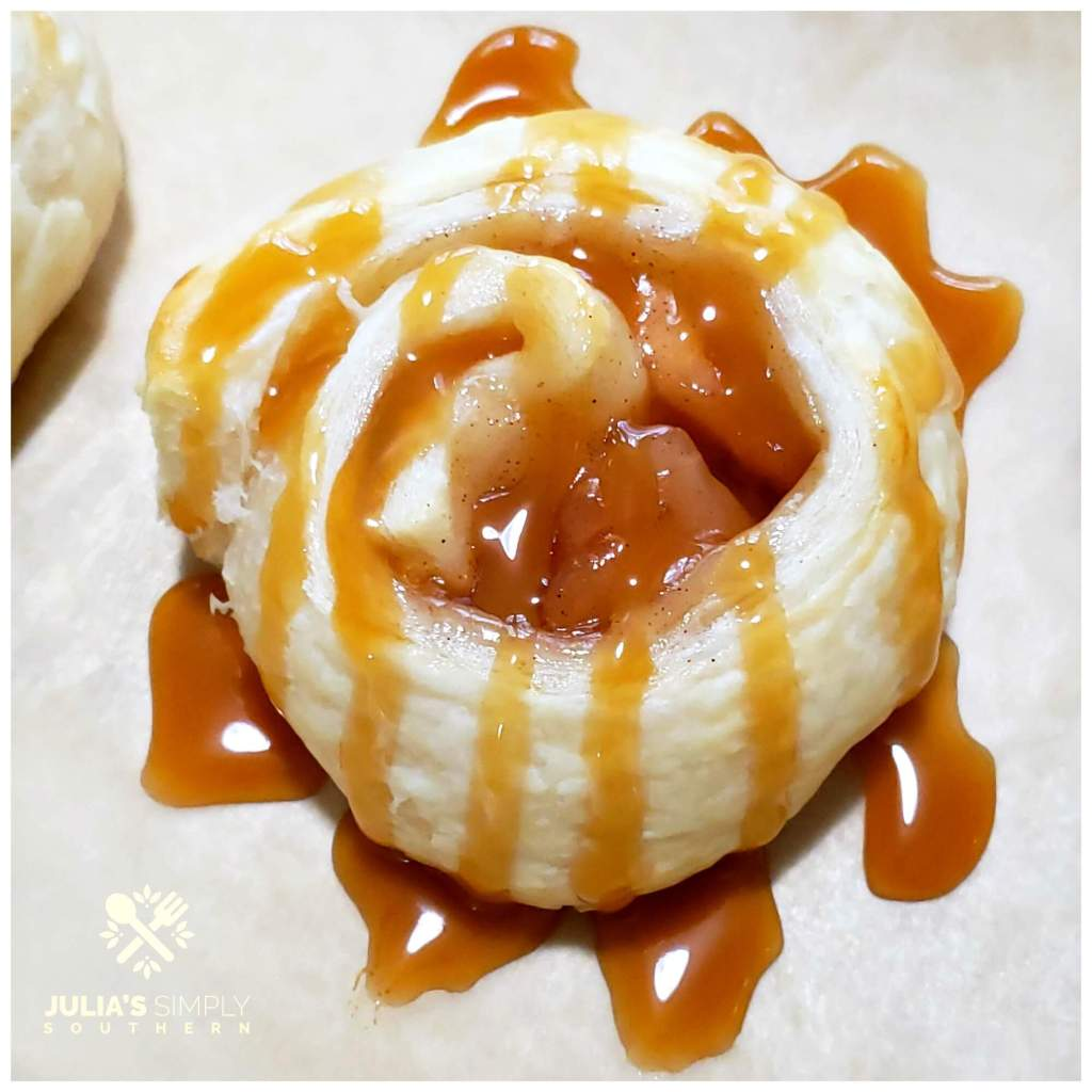 Apple and puff pastry roll ups drizzled with caramel sundae sauce