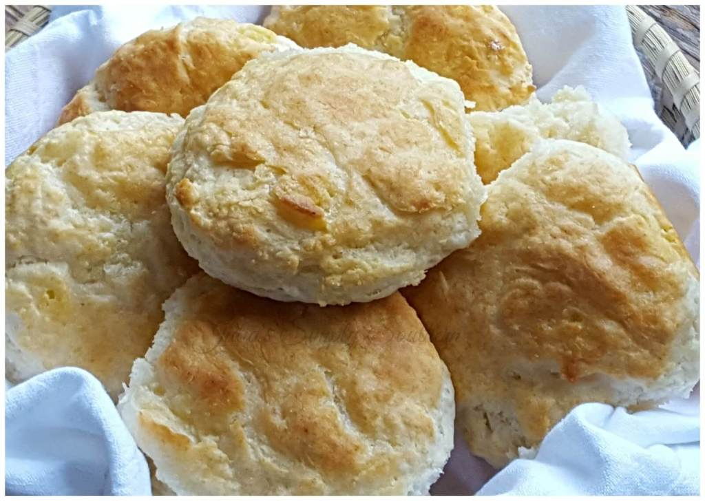 Homemade Southern Buttermilk Biscuits in a sweetgrass basket with cotton flour sack cloth