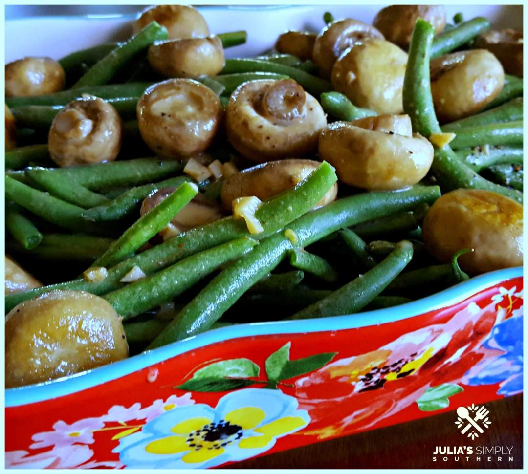 Fresh Green Beans and Fresh Mushrooms with garlic side dish in a red floral casserole dish