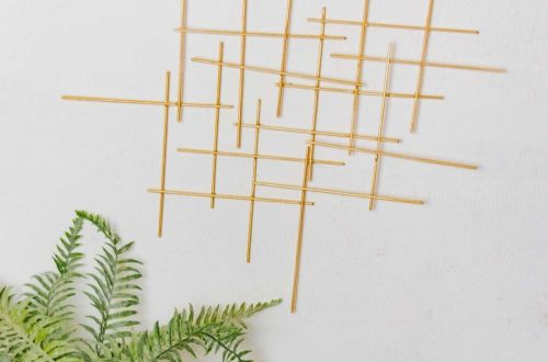 DIY Wanddeko in gold im Mid Century stil - deko aus holzspieße