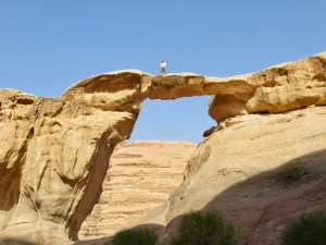 climbing rock formations in Wadi Rum