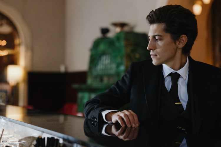 profile of man in black suit