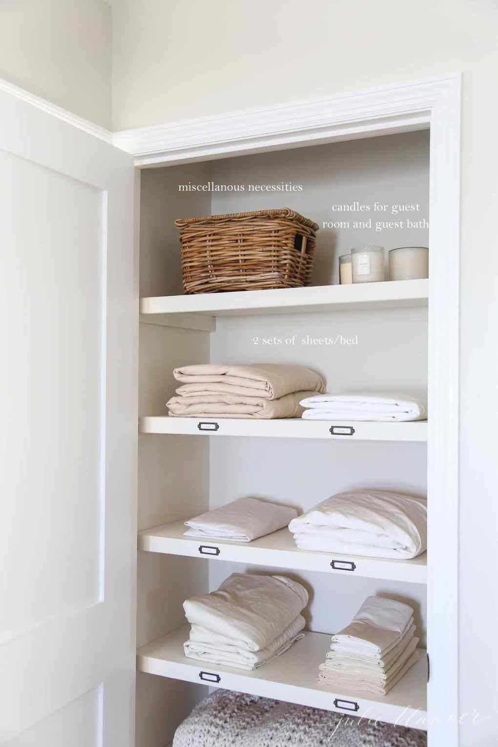 A linen closet stacked with sheets, baskets, etc, with white text overlay describing the items individually