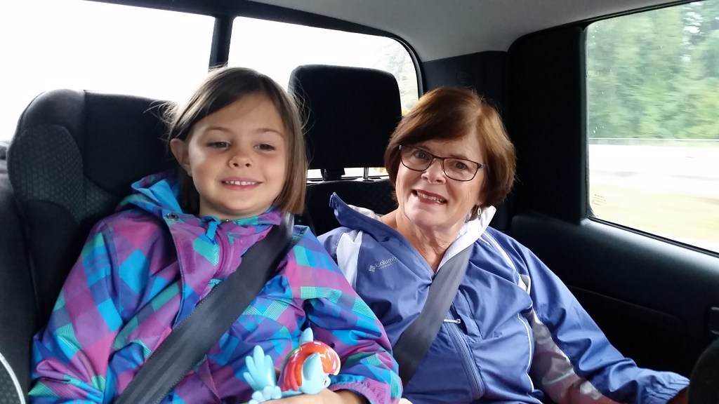 My daughter & my mom in the back of the truck