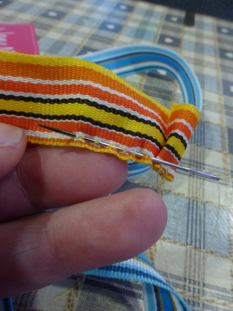 Running stitch to gather the ribbon.